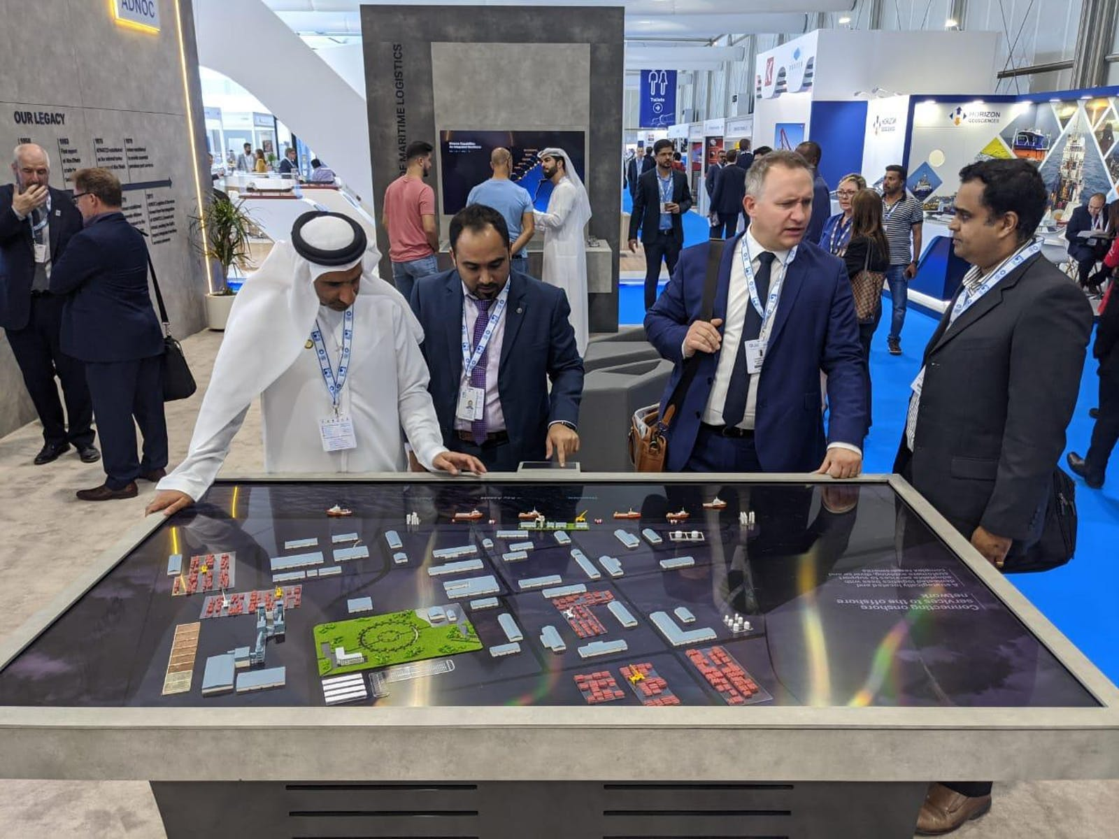 Adipec 2019 booths for Exxon, Adnoc and Emerson